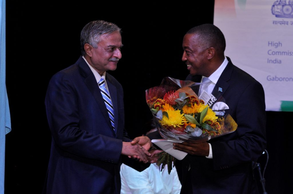 H.E. Dr. Ketan Shukla, High Commissioner of India to Botswana presenting bouquet to Hon. Mr. Thapelo Olopeng, Minister of Youth Empowerment, Sport and Culture Development of the Republic of Botswana on the occasion of Indian light-classical vocal concert by Ms. Shaila Hattangadi at Westwood International School on 25.10.2016