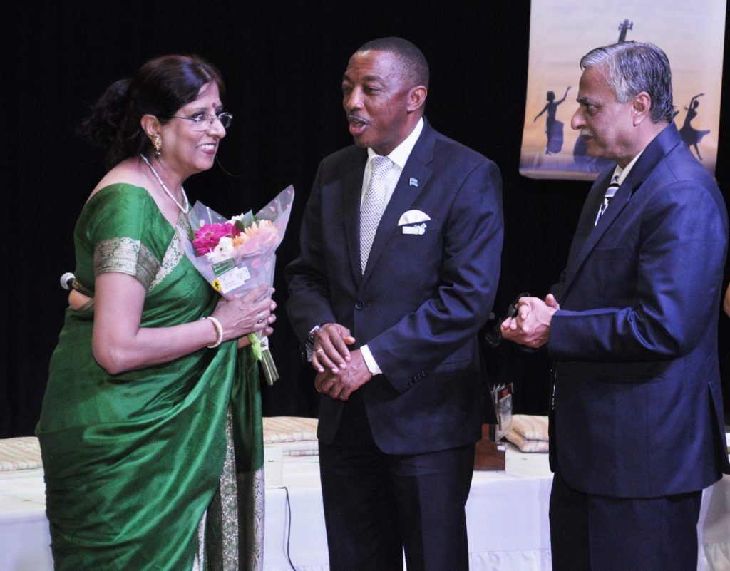 Hon. Mr. Thapelo Olopeng, Minister of Youth Empowerment, Sport and Culture Development of the Republic of Botswana presenting bouquet to Ms. Shaila Hattangadi, member of Indian light-classical vocal group on the occasion of Indian light-classical vocal concert by Ms. Shaila Hattangadi at Westwood International School on 25.10.2016. H.E. Dr. Ketan Shukla, High Commissioner of India to Botswana is on right.