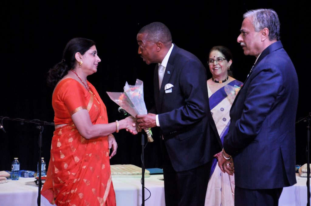 Hon. Mr. Thapelo Olopeng, Minister of Youth Empowerment, Sport and Culture Development of the Republic of Botswana presenting bouquet to Ms. Shobhana Rao, member of Indian light-classical vocal group on the occasion of Indian light-classical vocal concert by Ms. Shaila Hattangadi at Westwood International School on 25.10.2016. H.E. Dr. Ketan Shukla, High Commissioner of India to Botswana is on right.