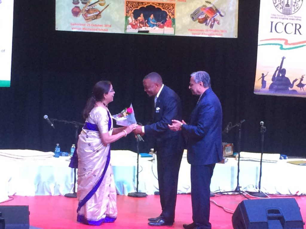 Hon. Mr. Thapelo Olopeng, Minister of Youth Empowerment, Sport and Culture Development of the Republic of Botswana presenting bouquet to Ms. Nirmala Jaishankar Bondal, member of Indian light-classical vocal group on the occasion of Indian light-classical vocal concert by Ms. Shaila Hattangadi at Westwood International School on 25.10.2016. H.E. Dr. Ketan Shukla, High Commissioner of India to Botswana is on right.