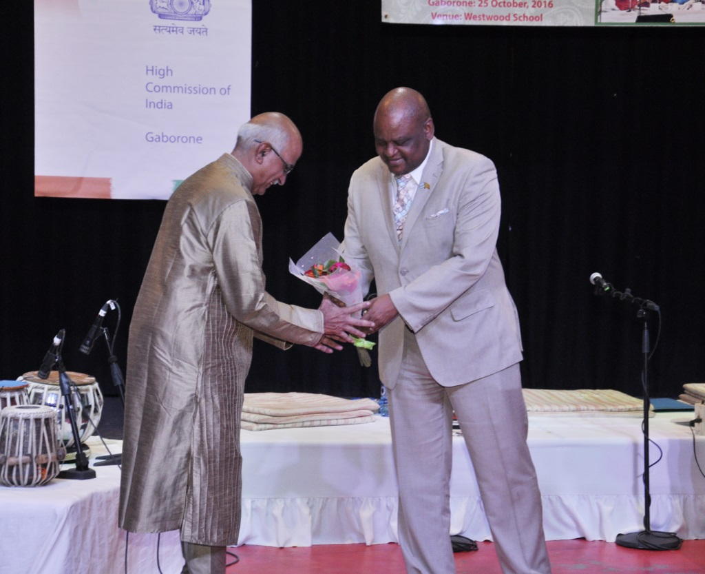 Hon. Mr. Dikgang Makgalemele, Assistant Minister of Health and Wellness of the Republic of Botswana presenting bouquet to Mr. Ashish Mishra, member of Indian light-classical vocal group on the occasion of Indian light-classical vocal concert by Ms. Shaila Hattangadi at Westwood International School on 25.10.2016